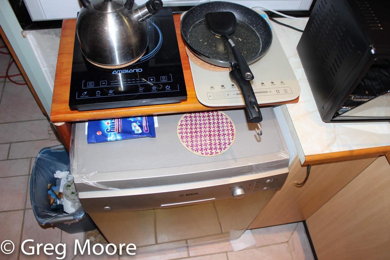 Induction cooktops over dishwashwer
