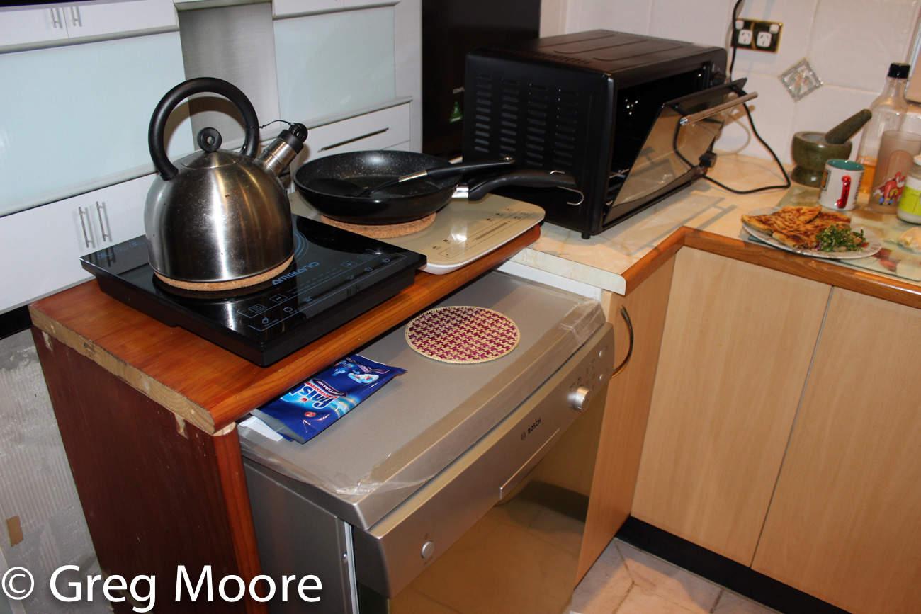 Dishwasher under cooktop